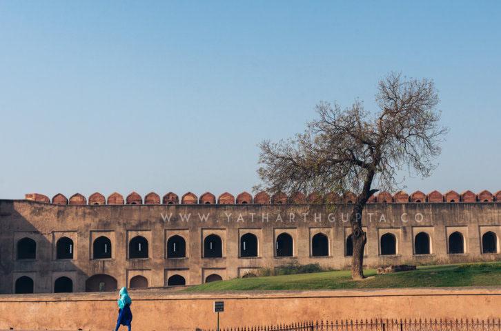 Blue Clothed Woman in Red Fort