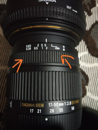 Sigma lens with distance marker useful for zone focusing