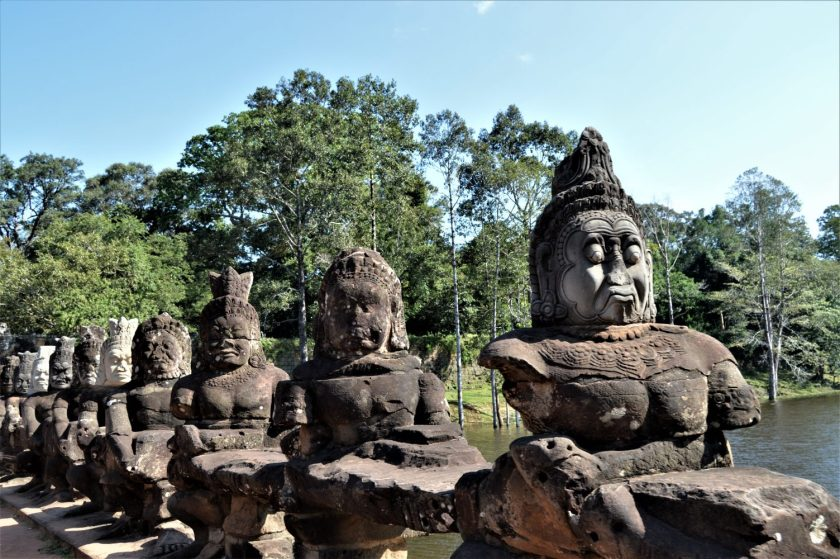 Statues of asuras (demons) on the pathway to the south gate of Angkor Thom in Siem Reap, Cambodia