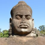 A statue of a deva on the pathway to the south gate of Angkor Thom in Siem Reap, Cambodia