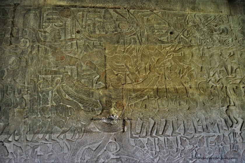 Angkor Wat - Krishna's Victory over Banasura bas-relief depicting Krishna riding Vishnu's vehicle Garuda and fighting Banasura