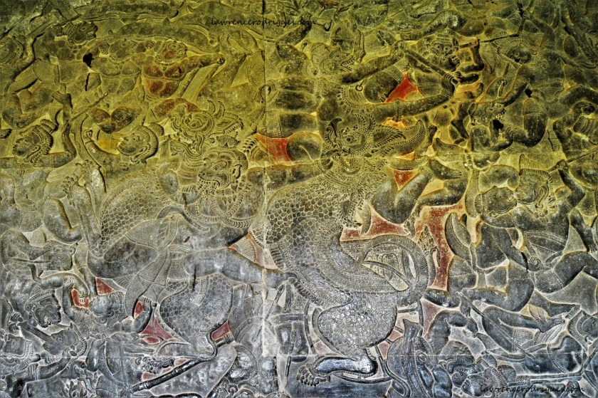 A combat scene in the Battle of Lanka relief depicting a monkey warrior subduing two lions carved in the lower-level gallery of the Angkor Wat Temple in Siem Reap, Cambodia