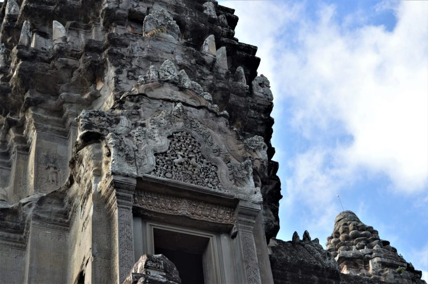 Arjuna vs. Karna battle depicted on the pediment of a corner tower located on upper level of the Angkor Wat Temple in Siem Reap, Cambodia