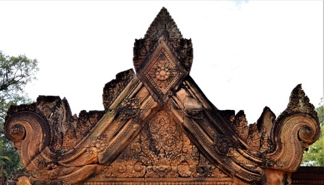 A beautifully decorated pediment of the east gopura of the middle enclosure with a bas-relief depicting time monster Kala.