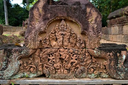 """The famous """"Ravana abducting Sita"""" scene from Ramayana is depicted on the east-facing pediment of the eastern gopura on the outer enclosure of the Banteay Srei temple"""