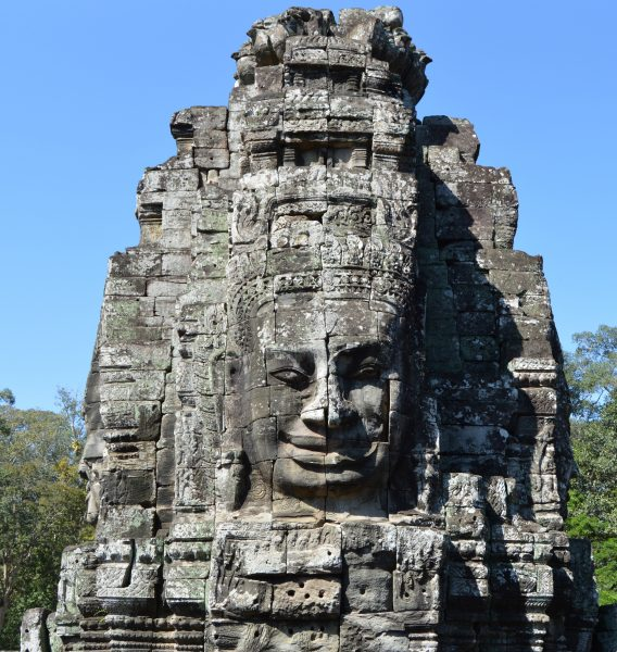 A smiling face carved on the upper-level tower of the Bayon Temple in Siem Reap, Cambodia