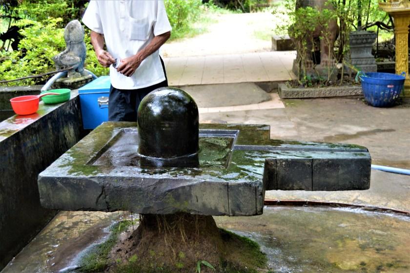 Shiva Linga near a Buddhist temple