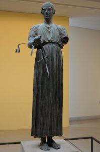 Bronze statue of a charioteer on display at the Delphi Archaeological Museum