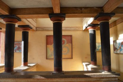 Reconstructed hall with columns and frescoes at the Knossos Palace in Crete, Greece