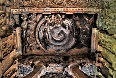 Coiled Nagaraja carved into the ceiling of the Durga Temple at Aihole in Karnataka, India