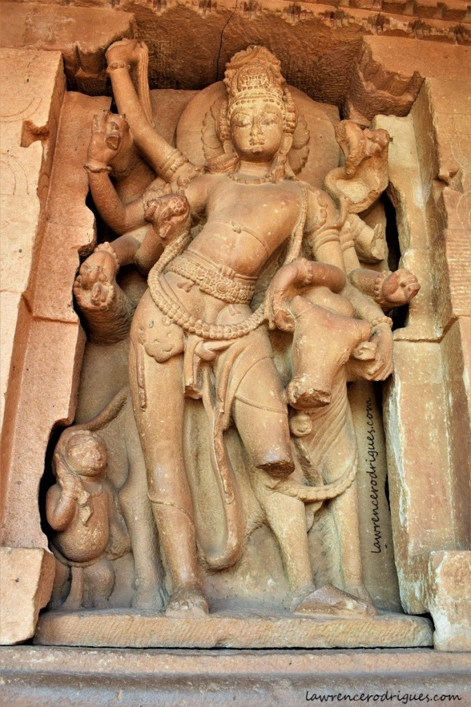 Shiva with Nandi installed inside the devakoshta of the Durga Temple in Aihole, Karnataka, India