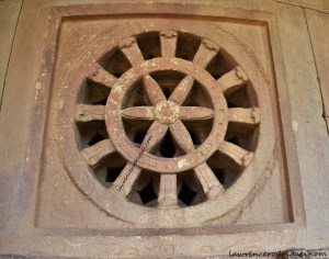 Jālandhara with a Dharmachakra pattern installed in a wall surrounding sbhamantapa and garbhagriha of the Durga Temple at Aihole, Karnataka, India