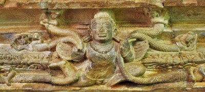 Garuda clasping snakes carved into the lintel of the sabhamanta door in the Durga Temple at Aihole in Karnataka, India