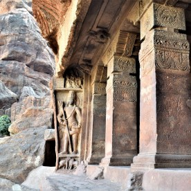 Dwarapala with Shiva-Parvati and Vrishabha-Kunjara - Left side view of Cave - 1, the first of the four of rock-cut caves of Badami, Karnataka, India