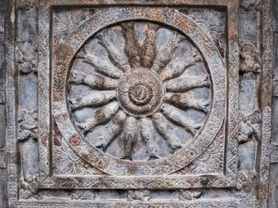 Matsya Chakra - A wheel with fish spokes carved on the ceiling of Cave - 2 located on a soft sandstone hill near Badami in Karnataka, India.