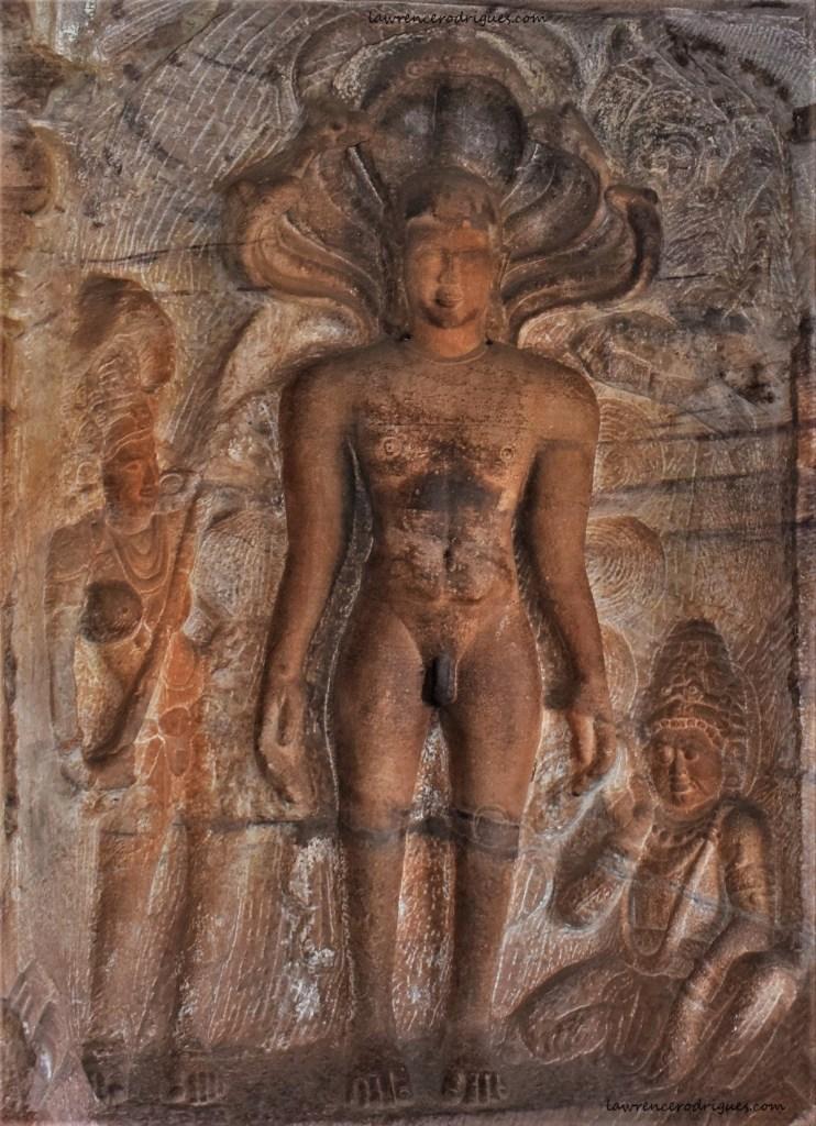Sculptural relief of Pārshvanātha, the 23rd Tirthankara carved in Cave - 4 of Badami Caves located in Karnataka, India