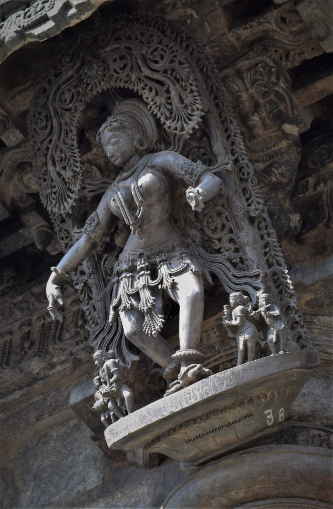 Nātya Sundari - A bracket figure mounted on a pillar at the main entrance to the Chennakeshava Temple in Belur, Karnataka