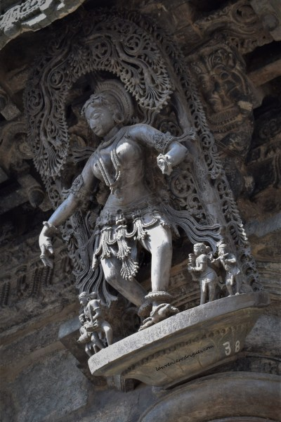 Dancing Shilabalike (damsel sculpted on stone) mounted on a pillar at the main entrance of the Chennakeshava Temple in Belur, Karnataka