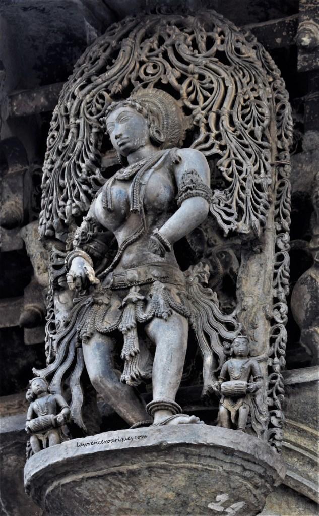 Nātya Sundari - Madanike with a traditional dancing stance - A bracket figure mounterd on the exterior wall of the Belur Chennakeshava Temple in Karnataka, India