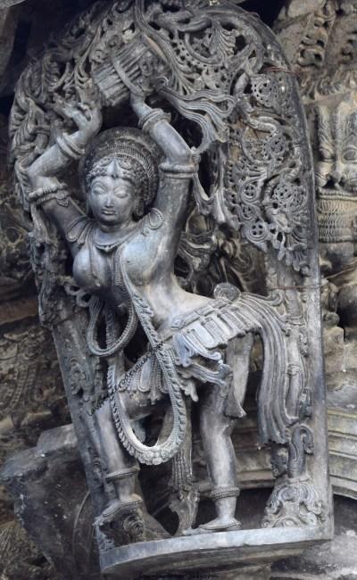 Tribhangi - A dolu playing shilabalike with the tribhanga dancing pose mounted on a pillar of the Chennakeshava Temple in Belur, Karnataka