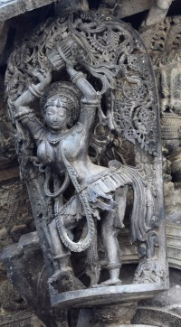 Tribhangi - A dolu playing shilabalike with the tribhanga dancing pose mounted on a pillar of the Chennakeshava Temple in Belur, Karnataka