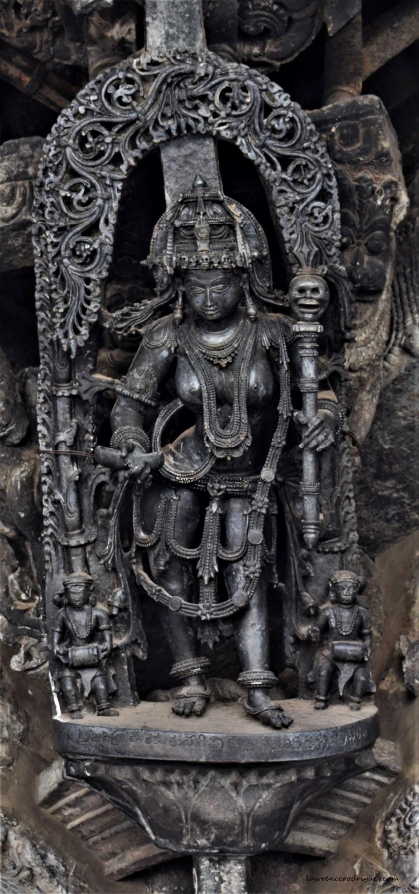 Kapala Durga - A bracket figure mounted on the exterior wall of the Chennakeshava Temple, Belur, Karnataka
