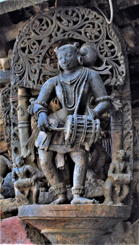 Dolu playing male musician - A bracket figure mounterd on the exterior wall of the Belur Chennakeshava Temple in Karnataka, India