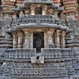 A chariot-like shrine built on the north side of the exterior wall surrounding girbagriha of the Belur Chennkeshava Temple in Karnataka, India