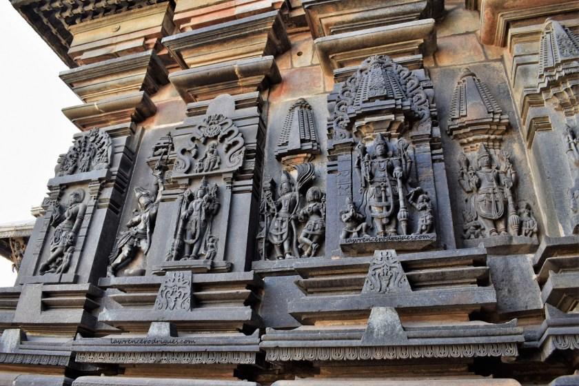 Reliefs on the north-side exterior wall surrounding garbagriha (inner sanctum) of the Belur Chennakeshava Temple in Karnataka, India