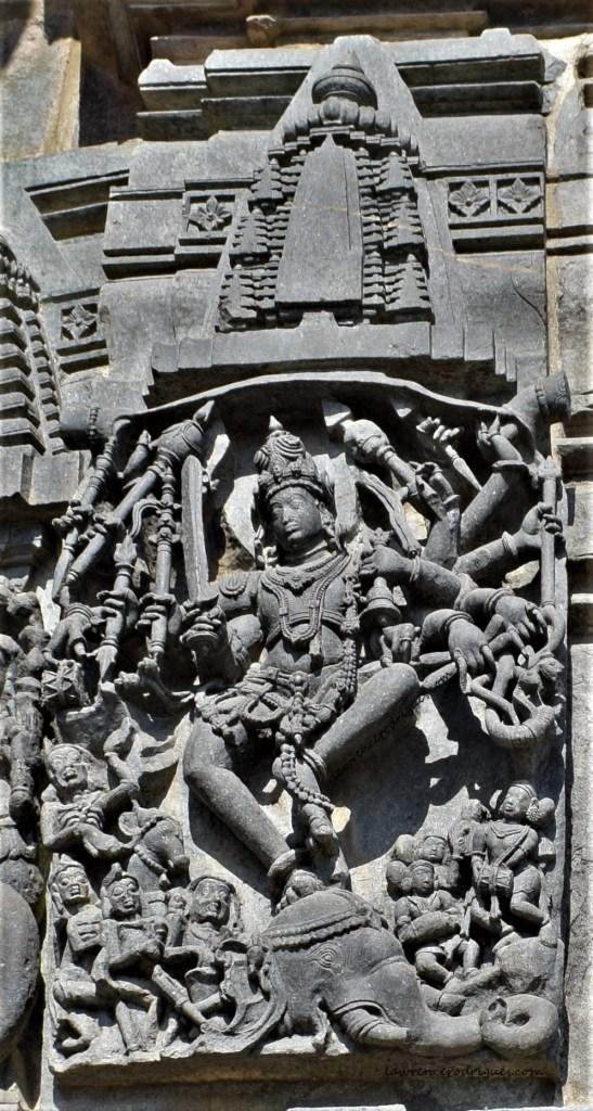 Shiva slaying Gajasura carved on the exterior wall surrounding the garbhagriha of the Belur Chennakeshava Temple in Karnataka, India