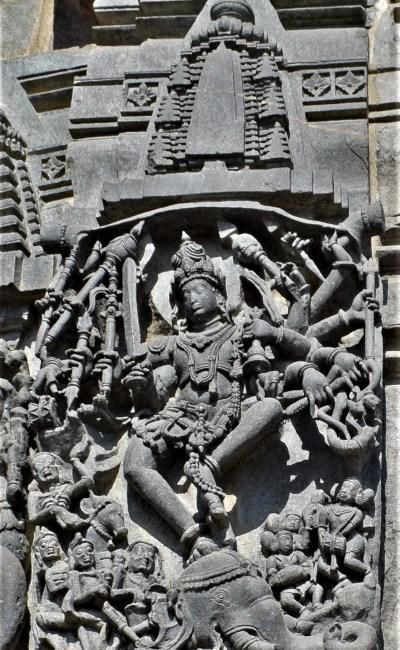 Belur Chennakeshava Temple - Shiva slaying Gajasura carved on the exterior wall