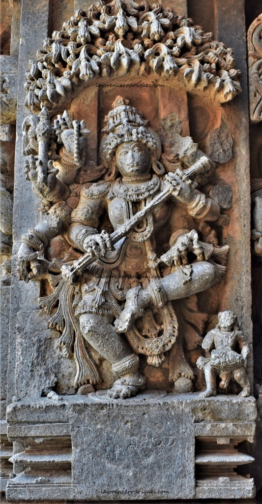 Sarasvati, the goddess of knowledge and learning, mounted on the outer wall of the Somanathapura Keshava Temple in Karnataka, India