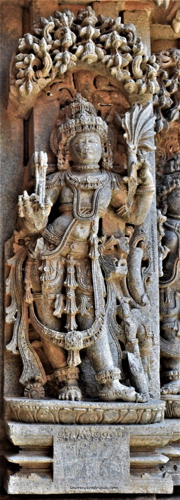 Manmatha, the god of love and desire carved on the outer wall of the Somanathapura Keshava Temple in Karnataka, India