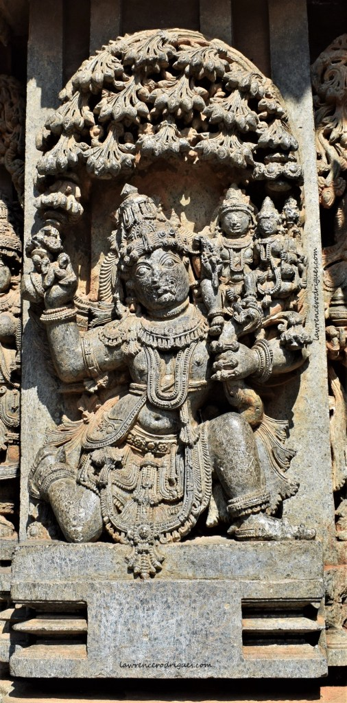 Garuda carrying Lakshminarayana mounted on the outer wall of the Somanathapura Keshava Temple in Karnataka, India