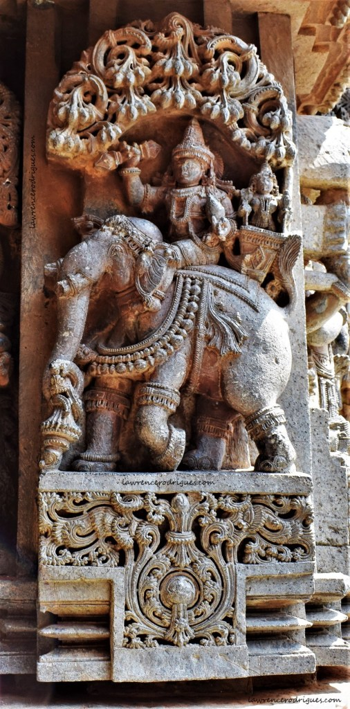 Indra and Indrani riding Airavata - A relief carved on the outer wall of the Somanathapura Keshava Temple in Karnataka, India
