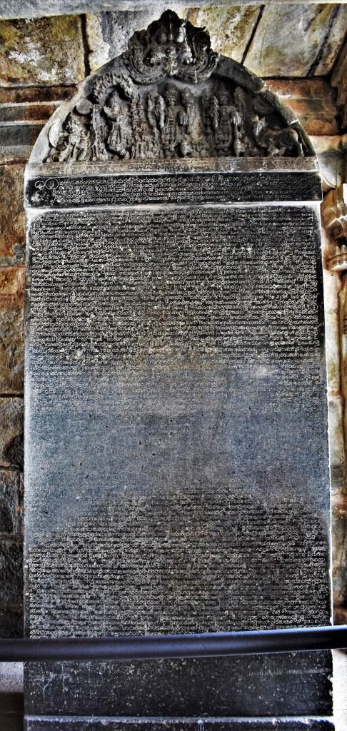 A stone slab with an inscription erected inside the Mahadvara (main door) pavilion of the Somanathapura Keshava Temple in Karnataka, India