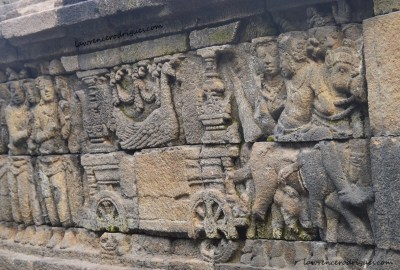 A bas-relief depicting a majestic peacock riding a chariot carved in the Rupadhatu layer of Borbudur in Yogyakarta, Indonesia