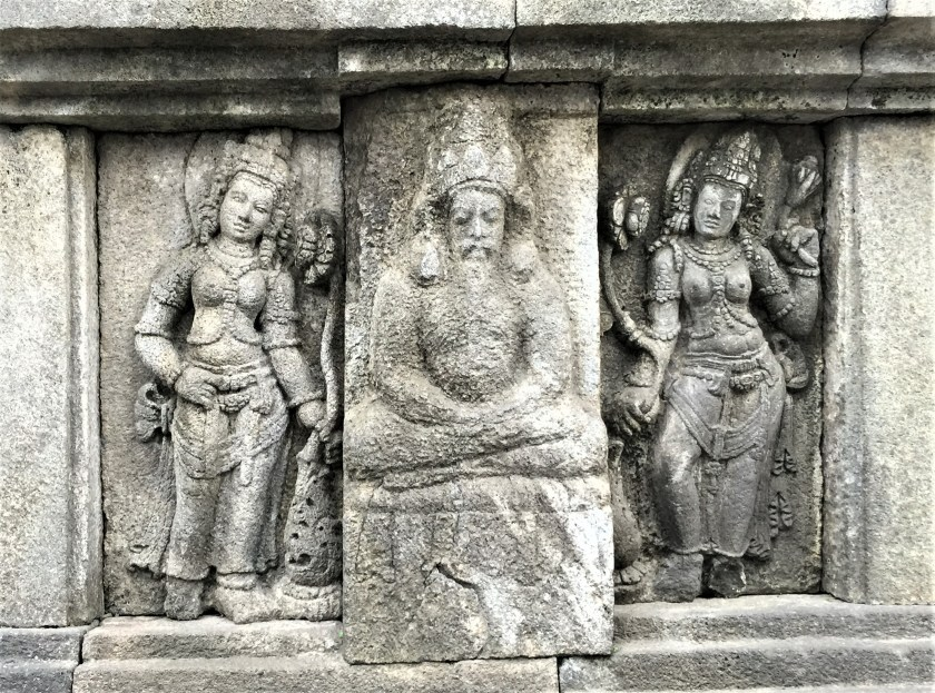 A rishi flanked by apsaras