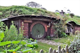 A Hobbit hole with the gone fishing sign in the Hobbiton Movie Set in Matamata, New Zealand