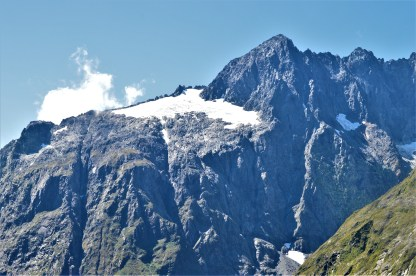Mountain tops with melting ice at the Fiordland National Park in the South Island of New Zealand