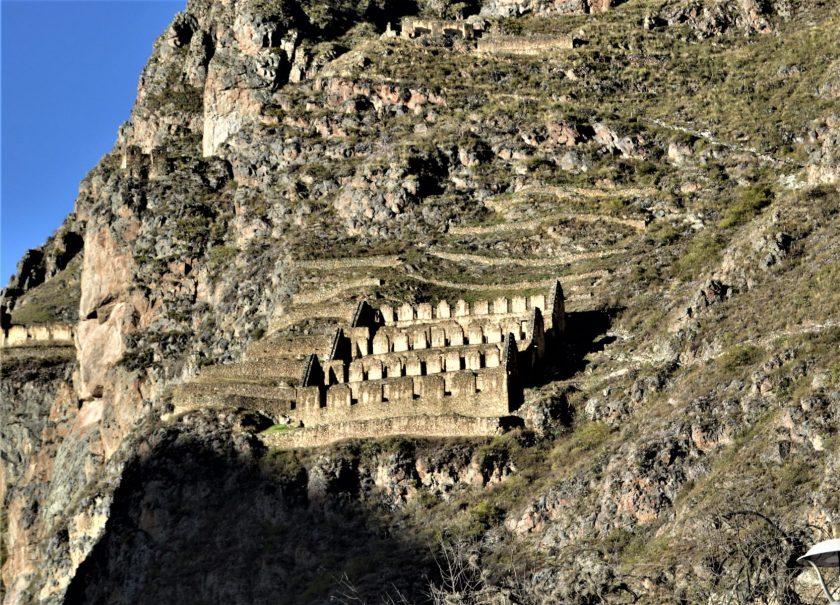 Qullqa - Inca food storage structure built on a mountain in Ollantaytambo, Cusco, Peru