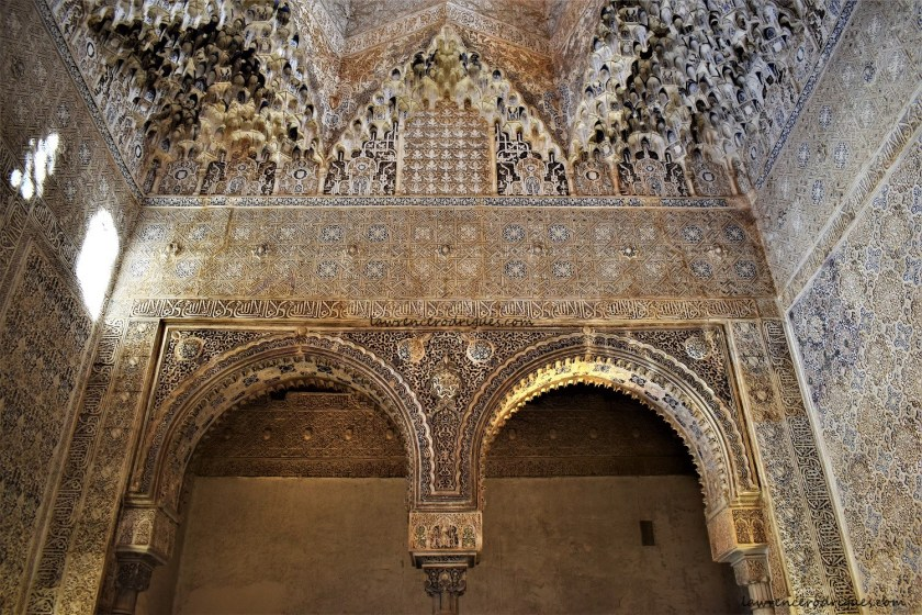 A sidewall with two arches of the Hall of the Abencerrajes located inside the Nasrid Palaces in Alhambra, Granada, Spain