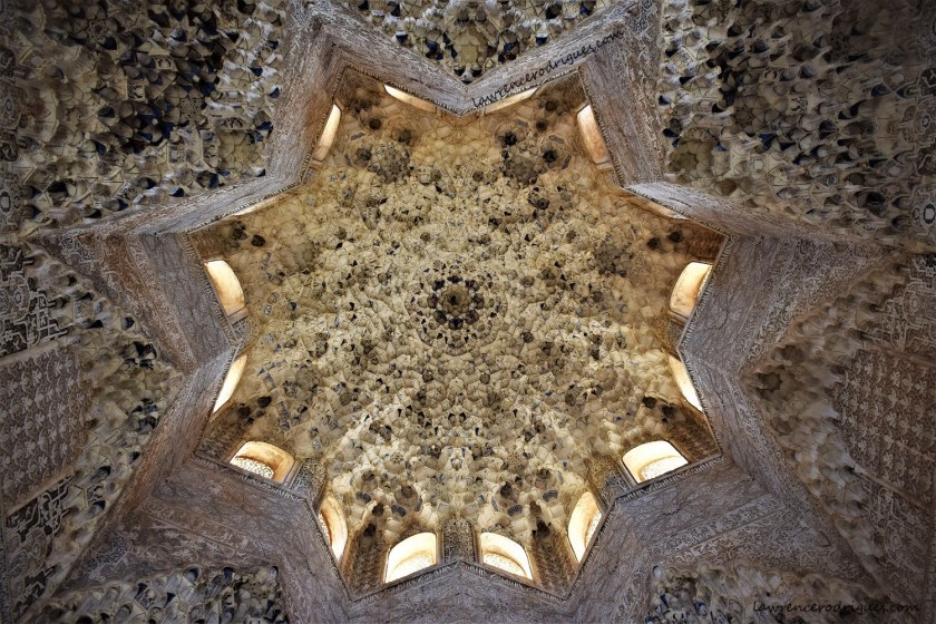 A view of the ceiling of the Hall of the Abencerrajes inside the Nasrid Palaces in Alhambra, Granada, Spain