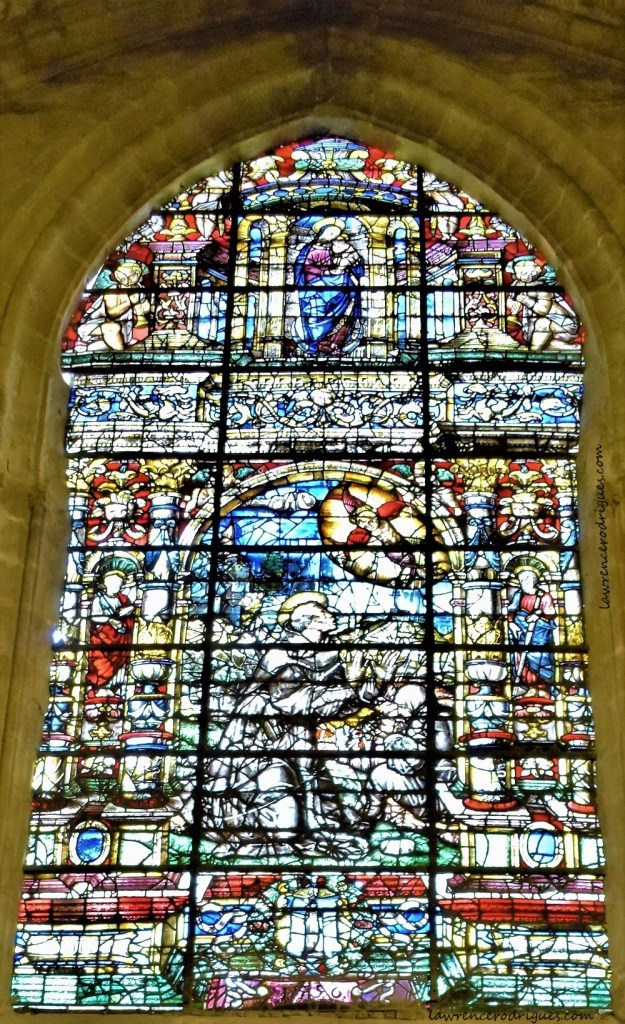 A stained glass window depicting St. Francis receiving the stigmata in the Capilla de San Fransciso in Seville Cathedral, Spain