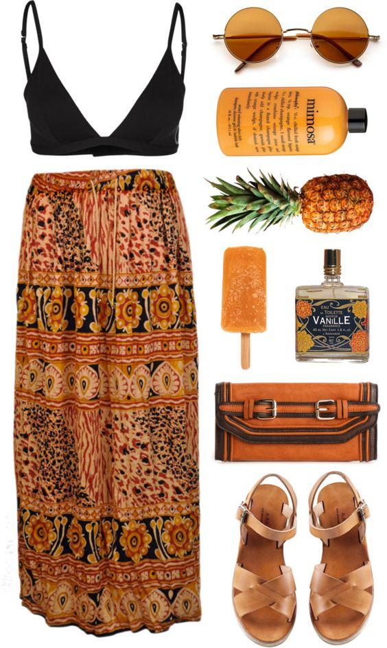 На фото: модный лук для знойного лета - юбка , топ, сандали, очки.