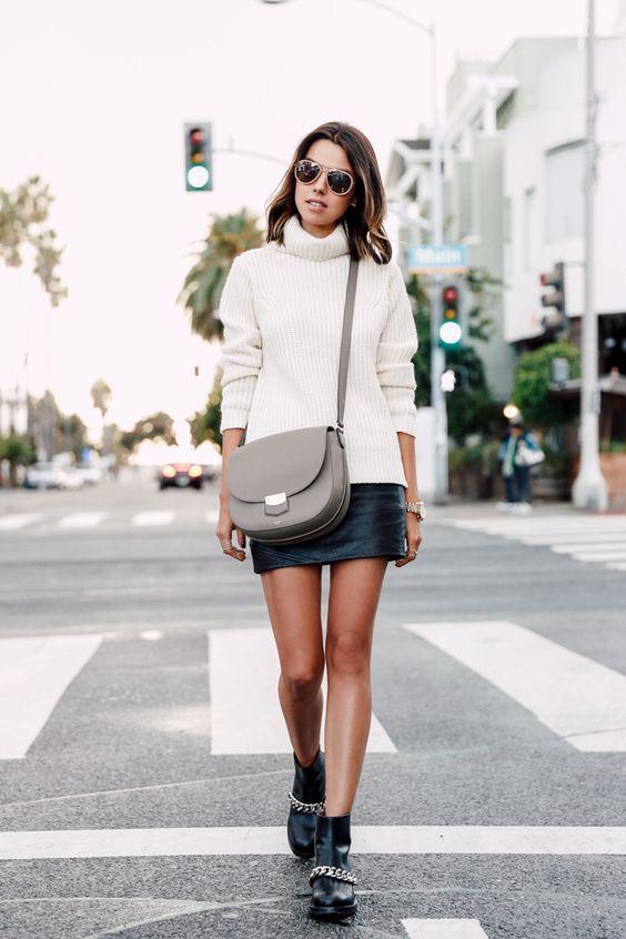 На фото: чёрные ботильоны с белым свитером и короткой черной короткой юбкой.