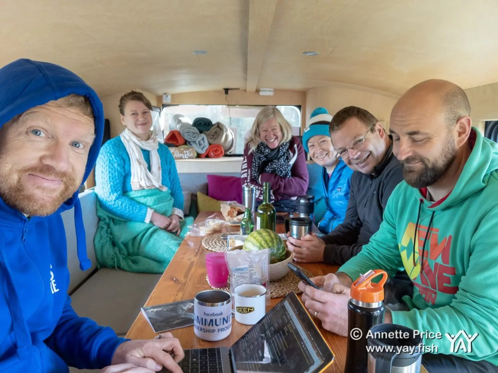 Around the breakfast table. Dave Cornthwaite (left). Wild camping course at the Yes Bus. Part of Say Yes More. West Sussex, UK.