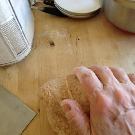 With my fingers, I pull the dough gently toward me, then with the heel of my hand, I roll the it gently back