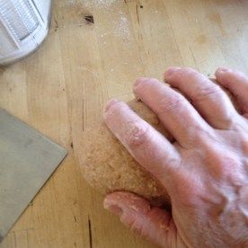 Without turning the dough, I repeat the pull and push motion, moving my hand slightly to the left as it pull