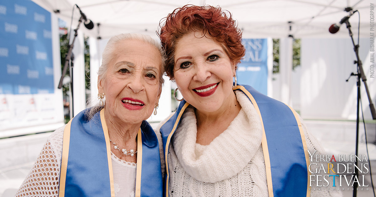 Photo of two members of Community Music Center Older Adult Choirs by Amal Bisharat Photography